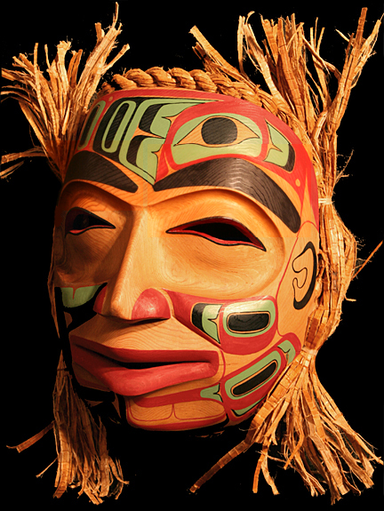 Carved Cedar mask featuring Haida Formline drawings - Reg Davidson